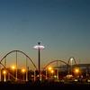 sunset over an amusement park in a distance