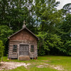old wood log cabin church in forest