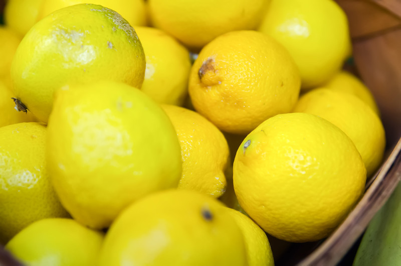 Colorful Display Of Lemons In Market in a basket