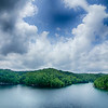 clouds and blue sky over summersville lake west virginia