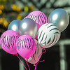 pink and white zebra balloons at breast cancer awareness