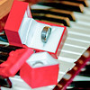 two wedding bands on piano keys