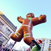 ginger bread cookie inflatable floating thru city streets