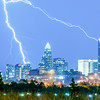thunderstorm lightning strikes over charlotte city skyline in north carolina usa