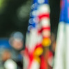 abstract and defocused image of a thanksgiving parade in a big city
