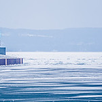 petorskey soast lighthouse on lake michigan in winter
