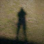 photographer shadow on green grss lawn