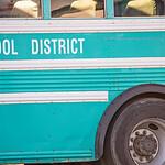 american school activity student ride bus