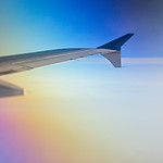 looking out of airplane window during flight