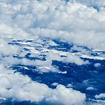 flying over clouds in united states