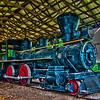 An old steam locomotive in a garage