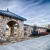 cultured stone terrace trellis details near park in a city