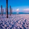 old sea pier ruins on the beach