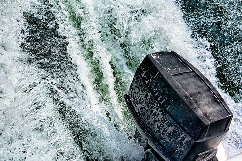 boat motor pushing water in lake