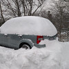 automobile covered in a pile of snow
