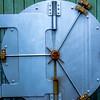 security vault door on green wall