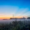 early sunrise over foggy farm landscape in rock hill south carolina