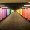 vanishing point of rainbow colored corridor at certain mall