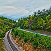 auto road and train tracks in virginia mountains